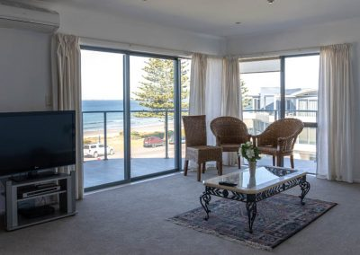 The Reef   3 Bedroom Top Floor Beachfront Apartment   Lounge with Beachfront View
