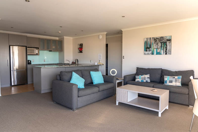 The Reef | 2 Bedroom Poolview Apartment | Lounge & Kitchen